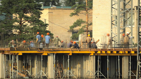 Builders in the construction site Stock Video Footage