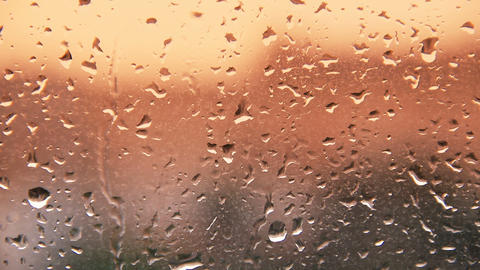 rain water drops on the windows glass during sunse Stock Video Footage