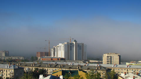 Timelapse of cityscape with fog Stock Video Footage