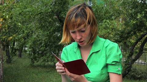 Young girl reading book Stock Video Footage