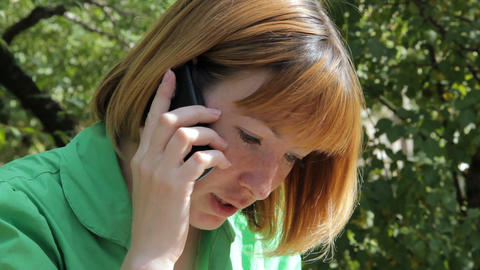 Pretty young girl talking on phone Stock Video Footage