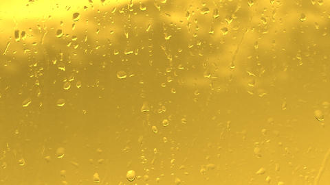 rain water drops on the golden surface Stock Video Footage