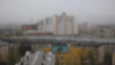 Snow with defocused building background Stock Video Footage