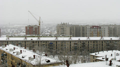 Time lapse of cityscape with falling snow Stock Video Footage