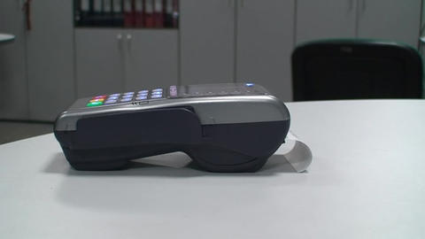 Swiping credit card with POS-terminal Stock Video Footage