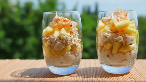 Vegan food, pineapple muesli yogurt coconut Stock Video Footage