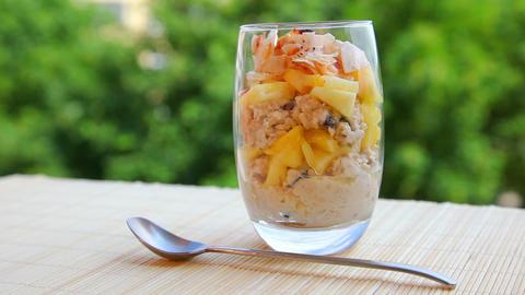 Vegan breakfast, pineapple muesli yogurt coconut Stock Video Footage