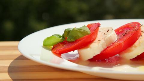 Caprese salad, tomato fresh mozzarella and basil Stock Video Footage