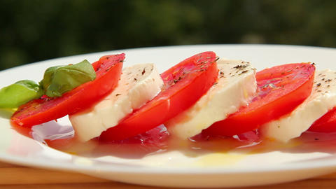 Caprese salad, tomato fresh mozzarella and basil Footage
