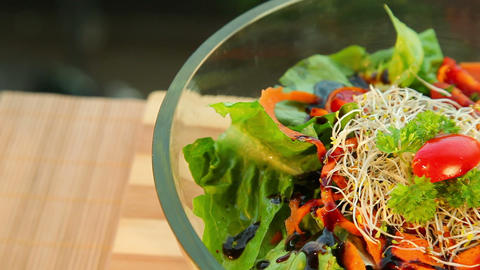 Bowl of fresh vegetable salad with dressing Stock Video Footage