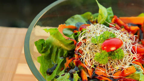 Bowl of fresh vegetable salad with dressing Footage