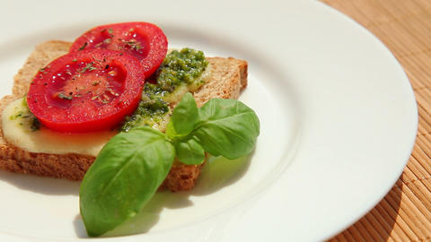 Delicious sandwich with pesto mozzarella tomato Stock Video Footage
