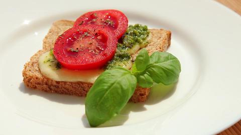 Delicious sandwich with pesto mozzarella tomato Stock Video Footage
