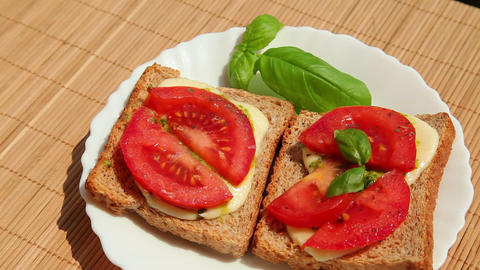 Sandwich brown bread pesto mozzarella tomato basil Stock Video Footage