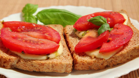 Sandwich with pesto mozzarella tomato and basil Stock Video Footage