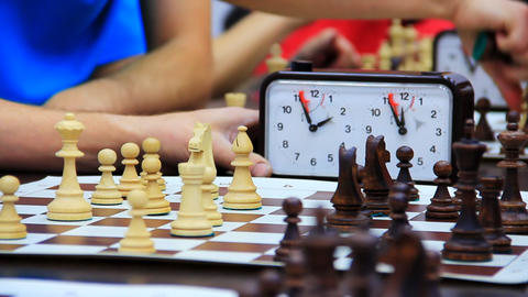 Close-up of chess game tournament with clock. Time Stock Video Footage