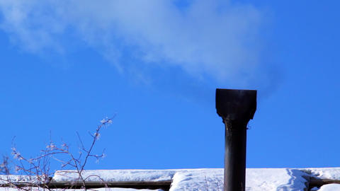 Smoking old chimney on the backdrop of clear blue Footage