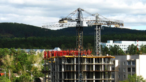 Fast time lapse of two tower cranes and constructi Stock Video Footage