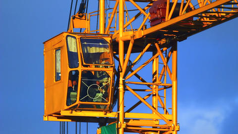Extreme close-up of working tower crane cabin at s Stock Video Footage