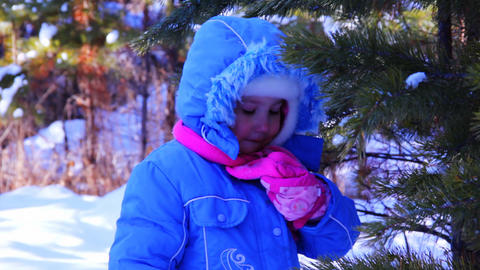 Little girl walking outdoor in the winter pine for Stock Video Footage