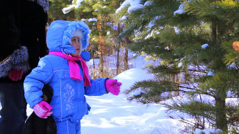 Little girl with mother walking outdoor in the win Stock Video Footage