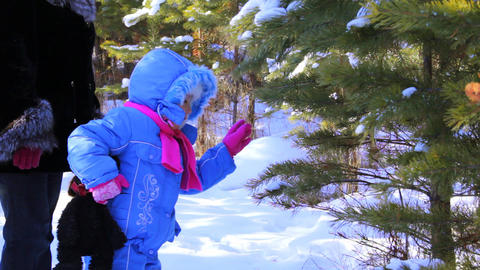 Little Girl With Mother Walking Outdoor In The Win stock footage