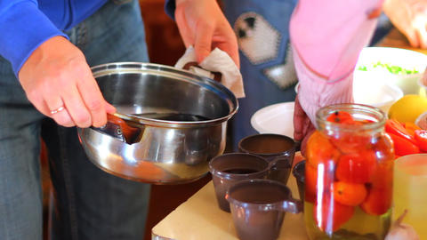Pouring hot mulled wine from the pot into the cups Stock Video Footage