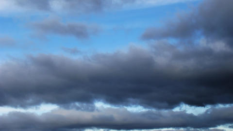 Time lapse of fast moving stormy clouds. No birds Stock Video Footage