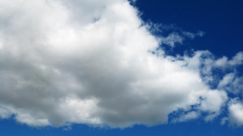 Time lapse of fast moving cumulus clouds over the Stock Video Footage