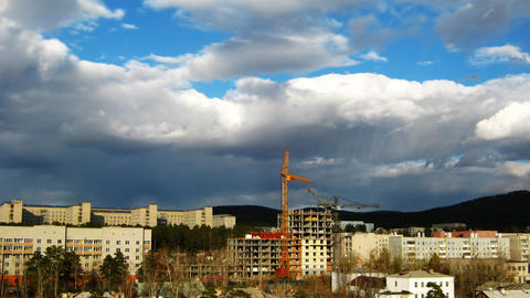 Cityscape with construction site and dramatic sky Stock Video Footage