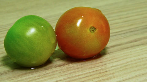Dolly shot of two tomatoes on the wooden desk tabl Stock Video Footage