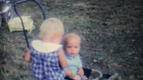 Girl Fussing Over Baby Sister At Picnic 1962 8mm Stock Video Footage