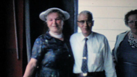 Grandparents Smiling For Camera At Reunion 1962 Stock Video Footage
