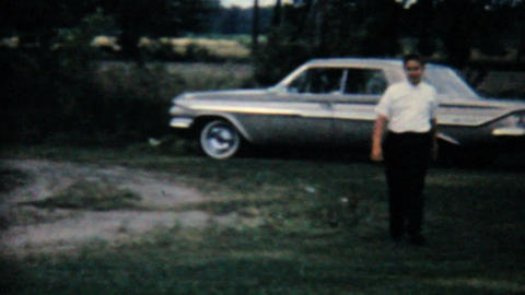 Man Walking Away From Classic Old Car 1962 Vintage Stock Video Footage