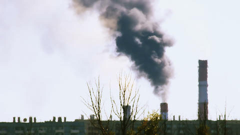 Smoking power plant in Russia during heat haze Stock Video Footage