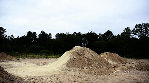 BMX biker jumping dirt jumps Stock Video Footage