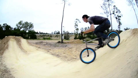 BMX biker jumping dirt jumps Footage