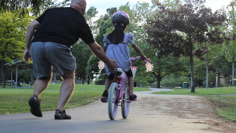 Little Girl Rides Her Bike For The First Time Footage