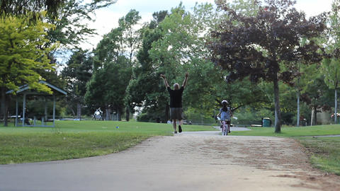 Little Girl Rides Her Bike For The First Time Stock Video Footage