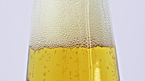 Beer bubbles in bottle neck Stock Video Footage