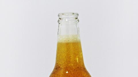 Freshly opened beer Stock Video Footage