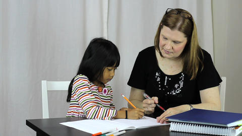 Homeschool Teacher Teaches Her Asian Daughter A Le Stock Video Footage