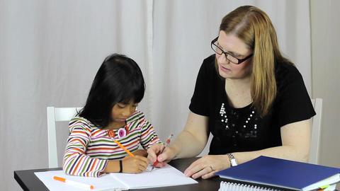 Homeschool Teacher Teaches Writing Lesson To Daugh Stock Video Footage