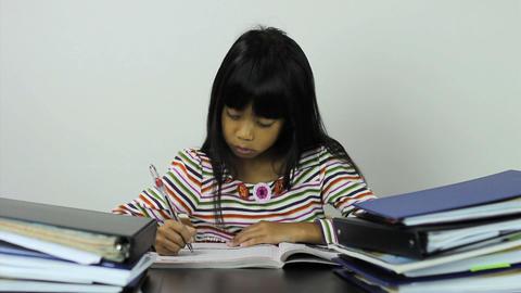 Little Asian Girl Doing Her Homework Stock Video Footage