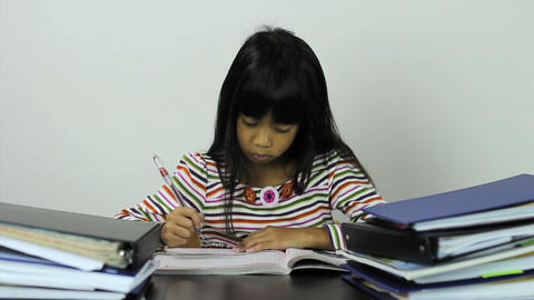 Little Asian Girl Doing Her Homework Stock Video Footage