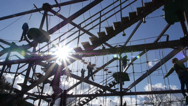 Families Play On Large Gorilla Climb Ropes Course stock footage