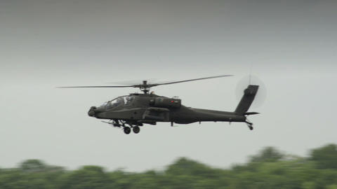 10943 Apache AH 64 Helicopter on patrol Stock Video Footage