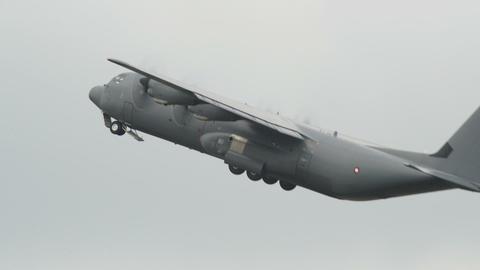 Lockheed C 130 J Super Hercules emergency take off Stock Video Footage
