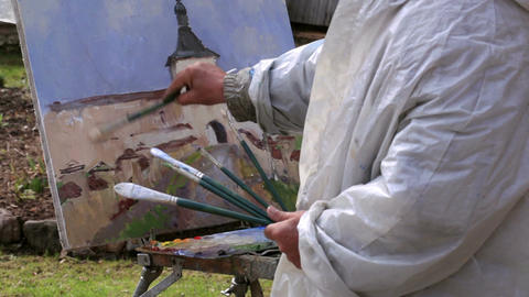 Artist paints a picture of Kirillo-Belozersky Mona Stock Video Footage