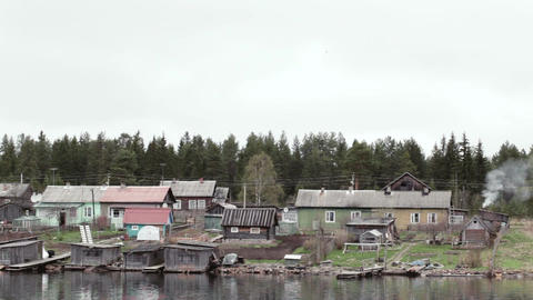 Old village houses on the river Volga in Russia Footage